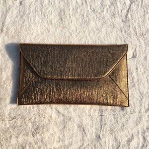 Handbags - New Gold textured clutch